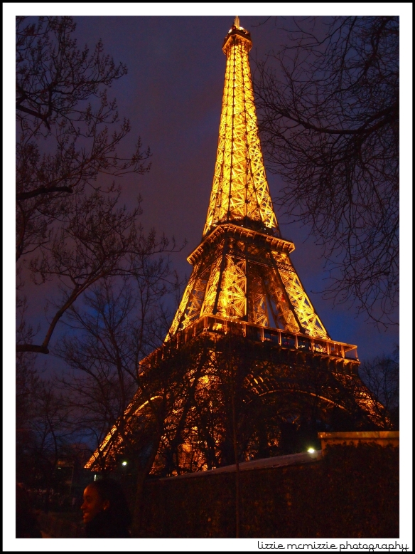 eiffel tower at night, watermarked