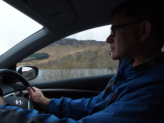 Dad focusing intently while learning to drive on the left - no easy feat!