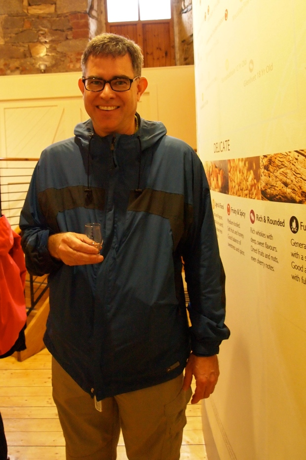 Looking gleeful with a sample of Oban scotch in hand!