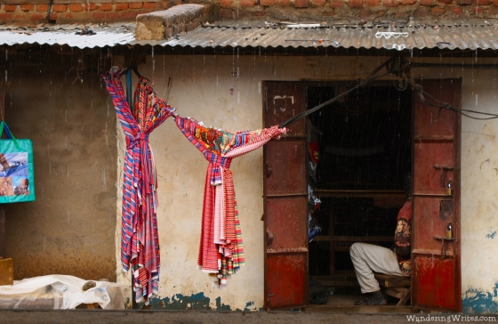 In the Kotido market, during a rainstorm.